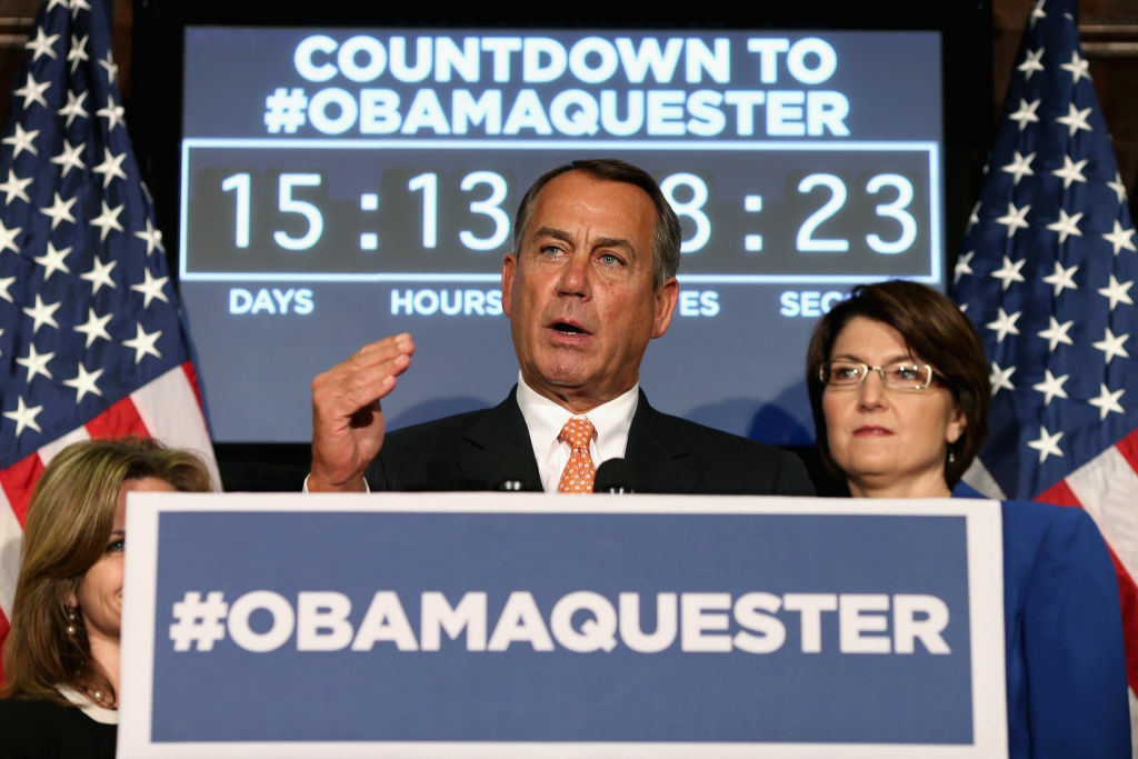 Speaker of the House John Boehner (R-OH) (C) answers reporters' questions during a news conference with (L-R) Rep. Martha Roby (R-AL) (obscured) and Rep. Cathy McMorris Rodgers (R-WA) at the Republican Party Headquarters on Capitol Hill February 13, 2013 in Washington, DC. The House Republican leaders squarly layed blame for the pending fiscal sequestration on President Barack Obama and said it was his and Senate Democrats who must avert the manditory spending cuts that will go into affect March 1.