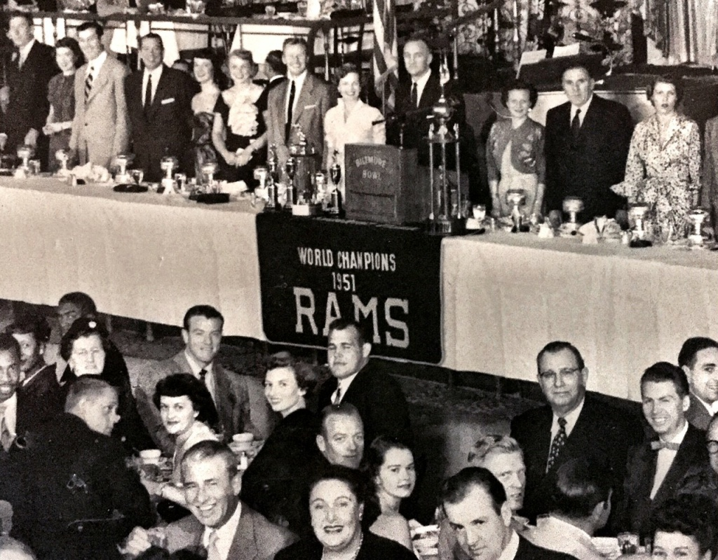 A celebratory banquet, with the Rams banner, which now hangs at Tom Bergin's, draped in front of the podium.