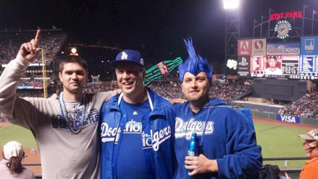 Photo of Jonathan Denver (pictured left) with his father (center) and brother at a Dodgers-Giants game in San Francisco, hours before Denver was fatally stabbed in an argument near the stadium.
