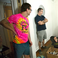 "Journalist David Farrier, left, and filmmaker Dylan Reeve, center, got more than they expected when they set out to make ""Tickled,"" a documentary about the world of competitive endurance tickling."