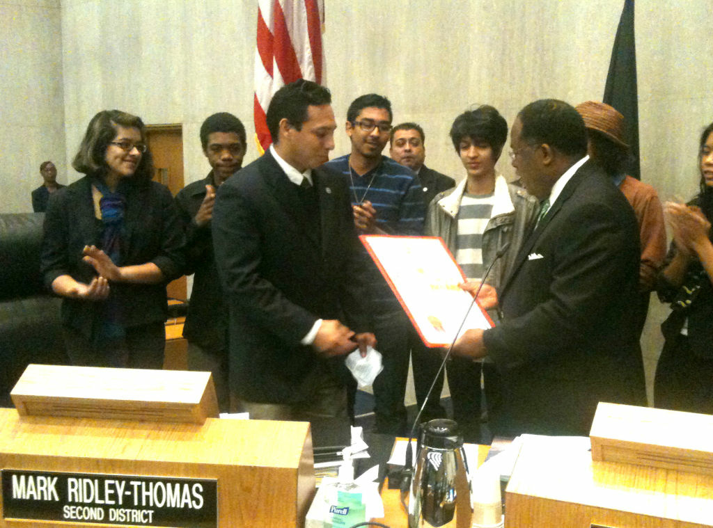 Members of the band The Bricks receive a recognition from L.A. County Supervisor Mark Ridley-Thomas.