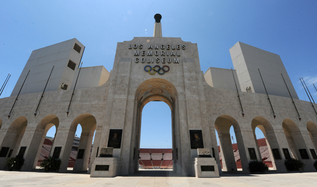 The Olympic evaluators will tour proposed venues, such as the Los Angeles Memorial Coliseum.