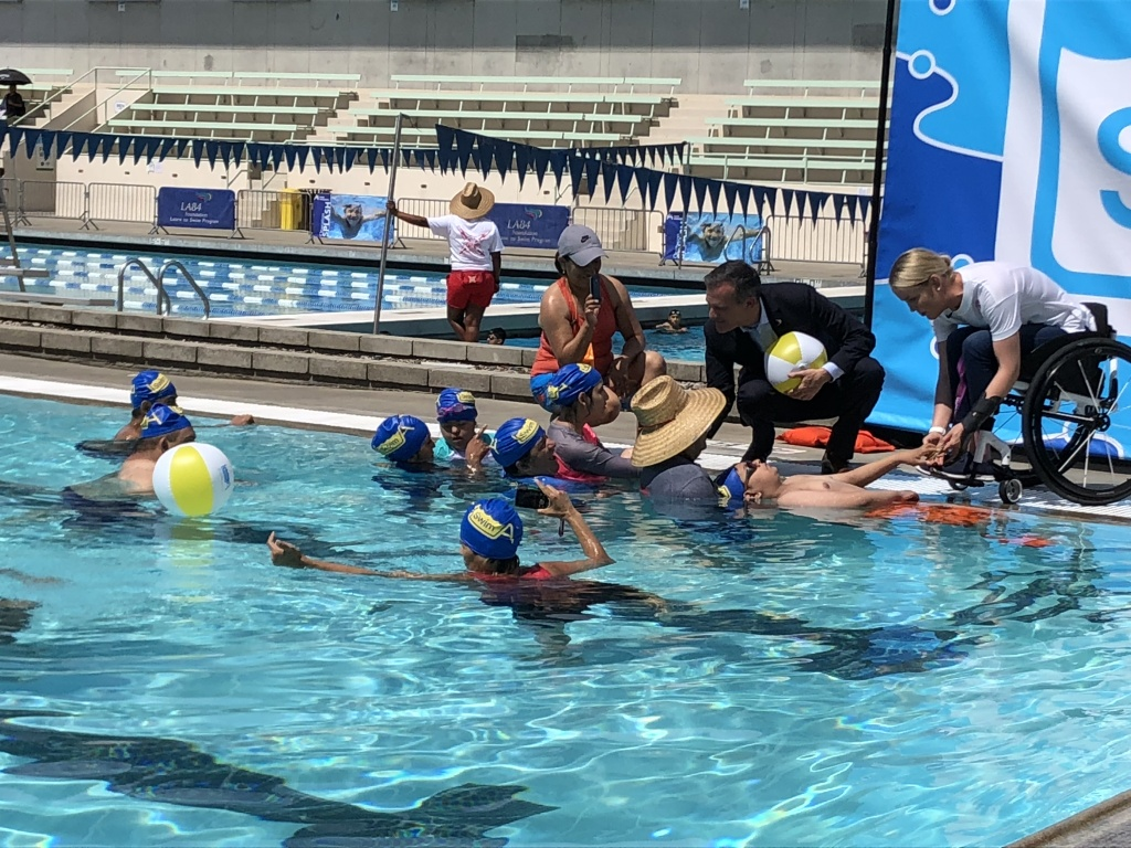 Mayor Eric Garcetti speaks to swimmers at the the EXPO Center pool in Exposition Park where he announced swim lessons for L.A. kids for little to no cost.