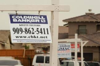 For sale signs line a residential street in Adelanto, California in the Mojave Desert. The housing market has struggled to regain momentum as home prices continued to fall during the past year.
