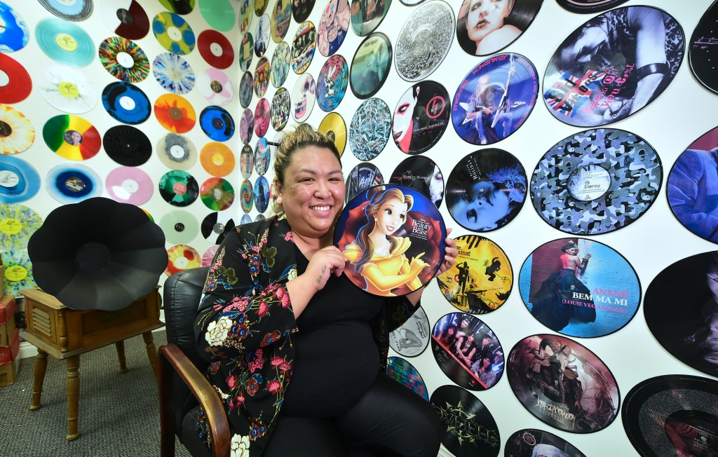 Ma Nerriza dela Cerna of Erika Records displays a full color
