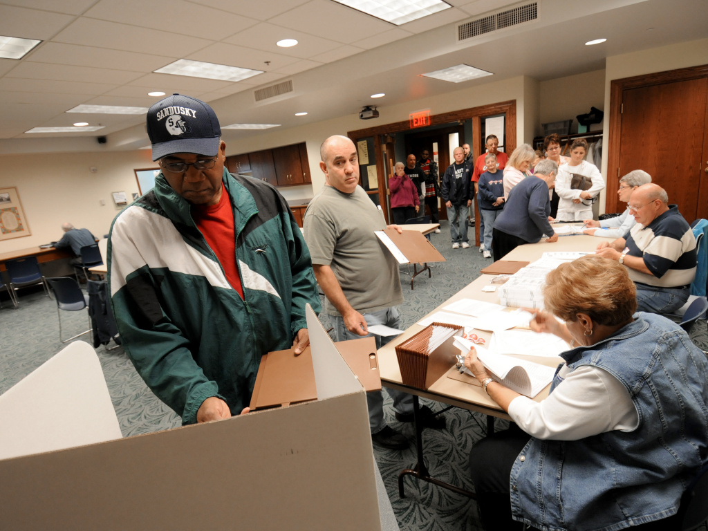 Commissioners in Sandusky, Ohio, have voted to make Election Day a city holiday, in place of Columbus Day. Sandusky resident Moses Croom is seen here voting at a polling station at a local library in November 2008.