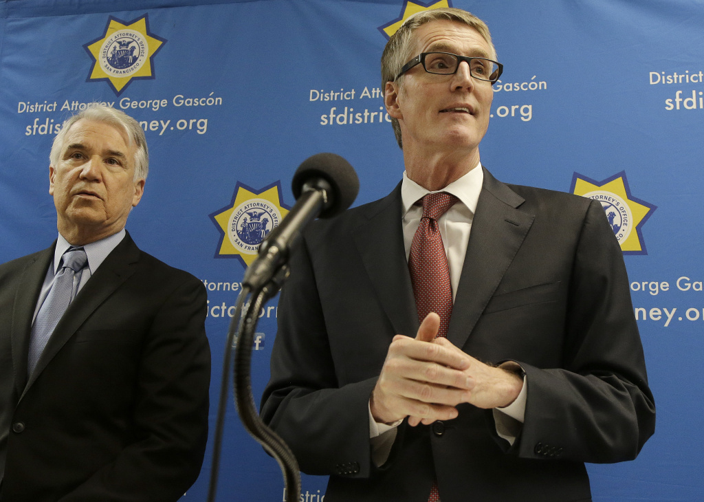 FBI Special Agent in Charge David J. Johnson, right, speaks next to San Francisco District Attorney George Gascón at a news conference in San Francisco, Tuesday, Feb. 16, 2016.
