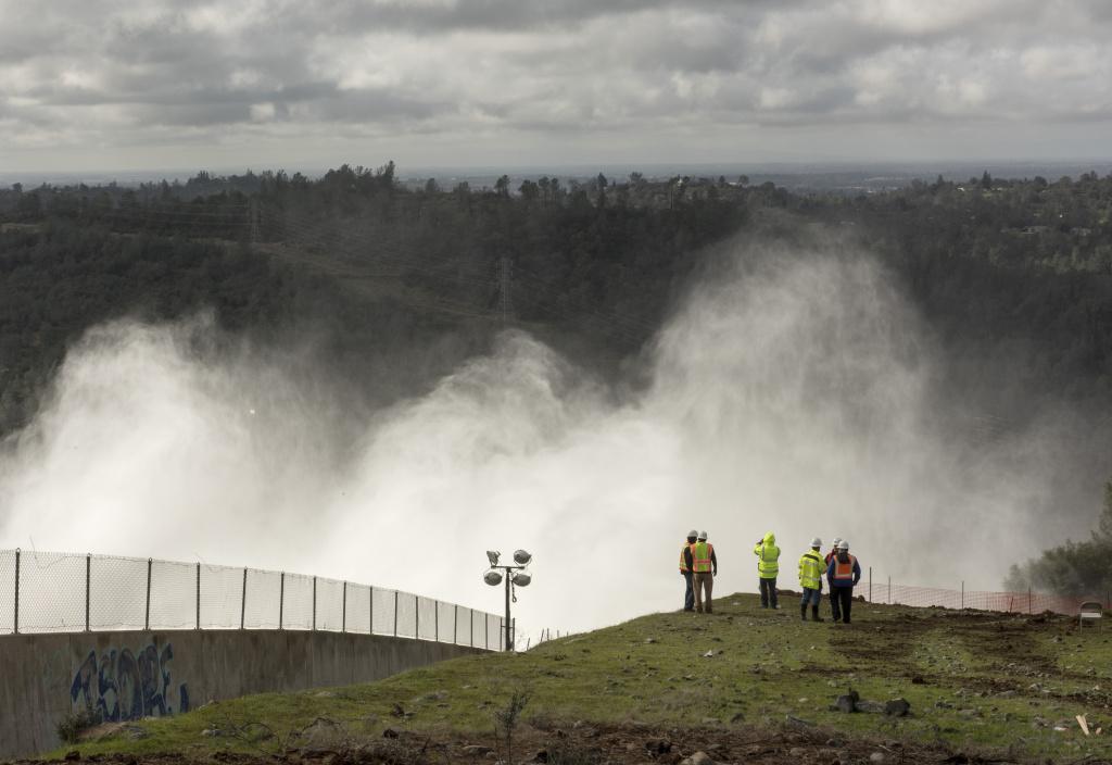 Slideshow: Slideshow: Water flowing over emergency spillway