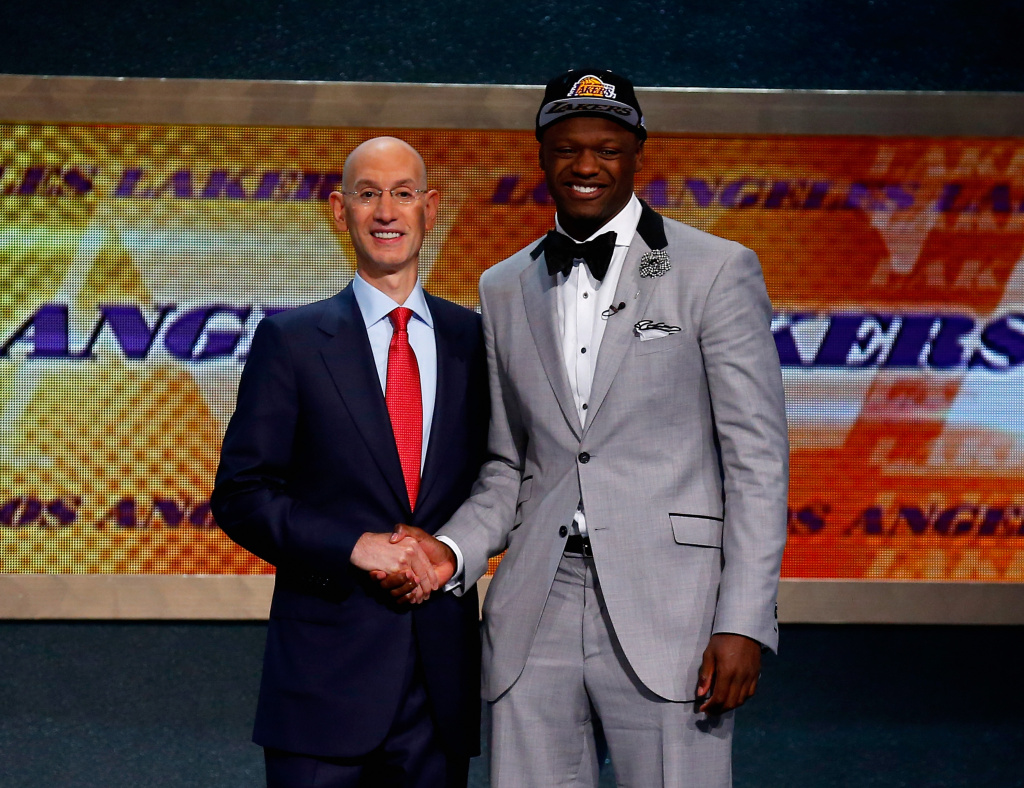 Julius Randle (R) of Kentucky shakes hands NBA Commissioner Adam Silver after being selected with the #7 overall pick by the Los Angeles Lakers during the 2014 NBA Draft at Barclays Center on June 26, 2014 in the Brooklyn borough of New York City.