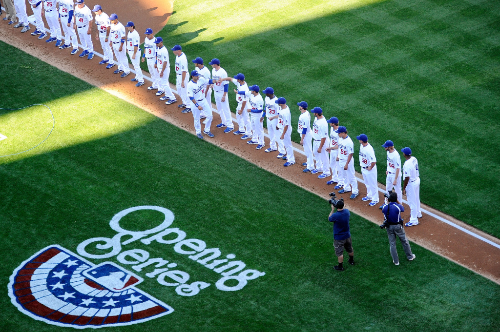Andre Ethier #16 of the Los Angeles Dodgers greets his teammates after being introduced on Opening Day prior to playing the San Francisco Giants at Dodger Stadium on March 31, 2011.