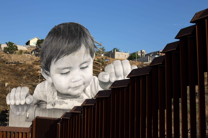 French artist JR is pictured near his artwork on the US-Mexico border in Tecate, California, United States on September 6, 2017.