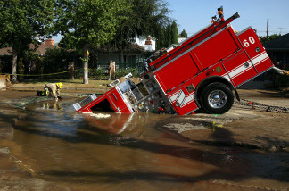 A fire truck was trapped in a sink hole last Fall caused by a water main break