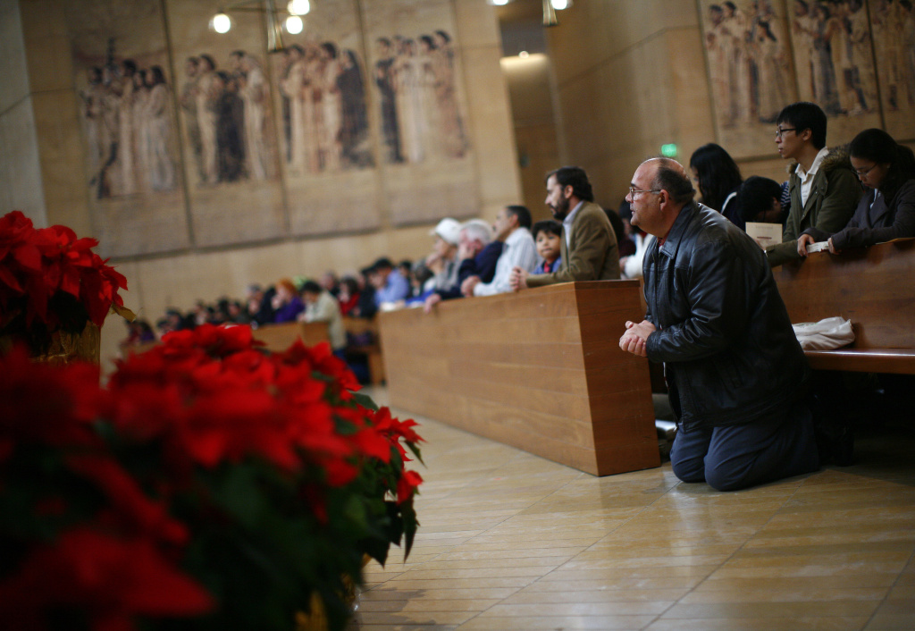 A parishioner kneels as Cardinal Roger Mahony leads Christmas mass at The Cathedral of Our Lady of the Angels December 25, 2010 in Los Angeles, California.