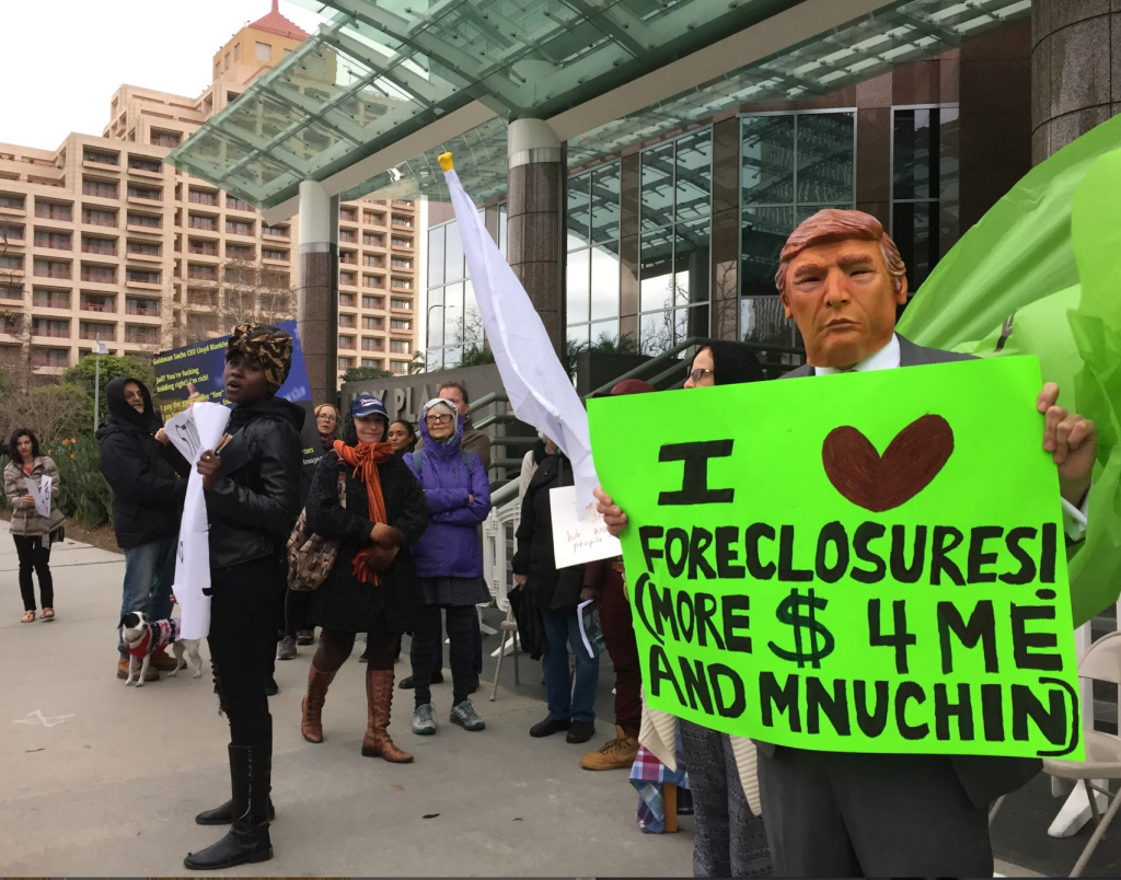 Community activists protest the nomination of Steven Mnuchin as Treasury Secretary outside the Goldman Sachs offices in Century City, and later, Mnuchin's Bel Air home.
