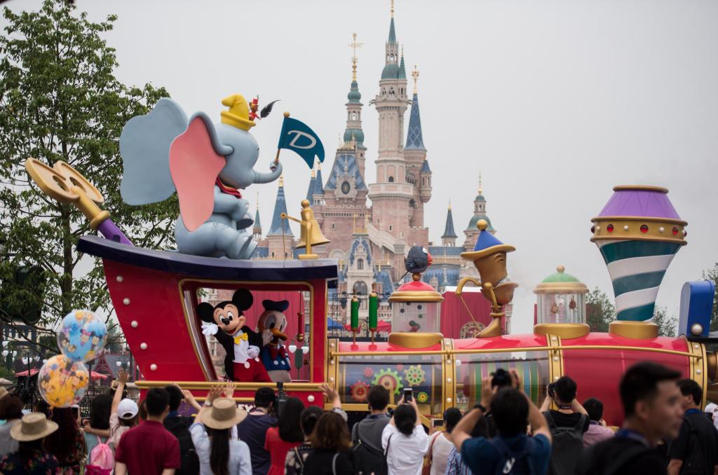 People watch the Mickey Parade at Shanghai Disney Resort in Shanghai on June 15, 2016.
