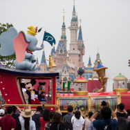 People watch the Mickey Parade at Shanghai Disney Resort in Shanghai on June 15, 2016.
