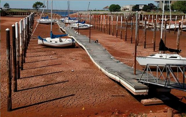 Sailboats and a floating dock lie on the dry, cracked dirt in a harbor at Lake Hefner in Oklahoma City during a 2011 drought.