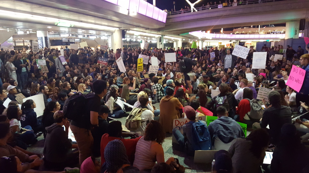 FILE PHOTO: Protesters convened outside the Tom Bradley International terminal at Los Angeles International Airport on Sunday, Jan. 29, 2017, following implementation of President Donald Trump's initial executive order effectively banning travel from seven majority Muslim nations.
