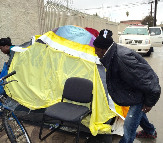 A tent in South LA caves under the weight of El Niño rains.