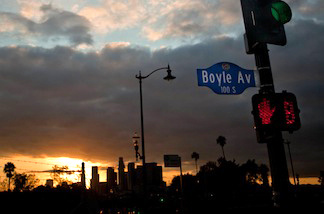 Looking out from near Mariachi Plaza, the sun sets over downtown Los Angeles on the evening of Sunday, March 27, 2011.