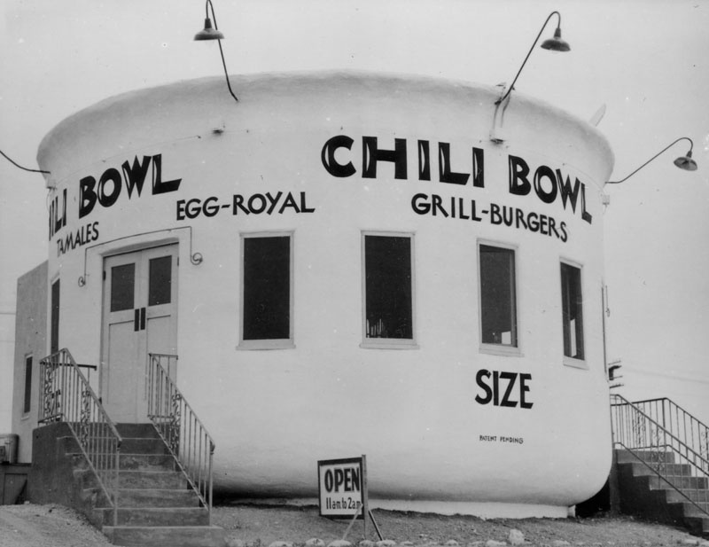 Launched in 1931 by former amateur boxer Art Whizin, the Chili Bowl chain had 22 outposts at its peak. Each building was round and shaped like a chili bowl with 26 stools around a circular counter where diners could get the signature dish: an open-faced burger blanketed with chili. This 1937 photo shows the original Chili Bowl, located at 3012 Crenshaw Boulevard.