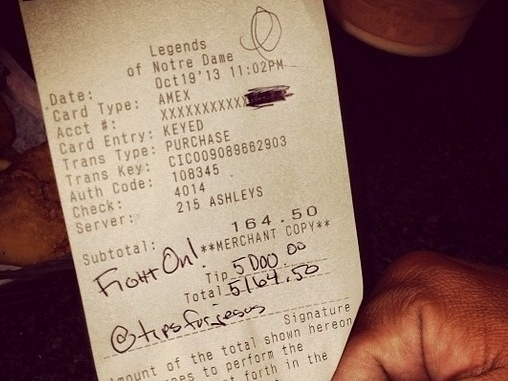 "One of the two checks that ""TipsForJesus"" signed at a restaurant in South Bend, Ind., on Oct. 19. The anonymous givers added $5,000 to each of the bills."