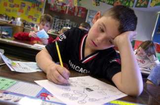 A student focuses on his schoolwork.