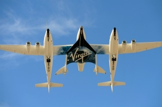 The Virgin Galactic VSS Enterprise spacecraft prepares to make it's first public landing during the Spaceport America runway dedication ceremony near Las Cruces, New Mexico on October 22, 2010.