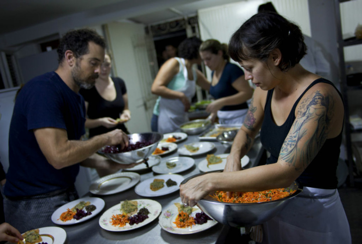 In this Dec. 7, 2012 photo, U.S. chef Kelsie Kerr gives a taste to fellow chef Jerome Waag as she prepares dinner at the private restaurant Le Chansonnier in Havana, Cuba. Kerr and Waag visited Cuba as part of the