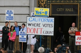 Supporters and opponents of same-sex marriage hold signs as they wait for a decision to lift a stay that would allow same-sex couples to marry in California August 12, 2010 in San Francisco, California.