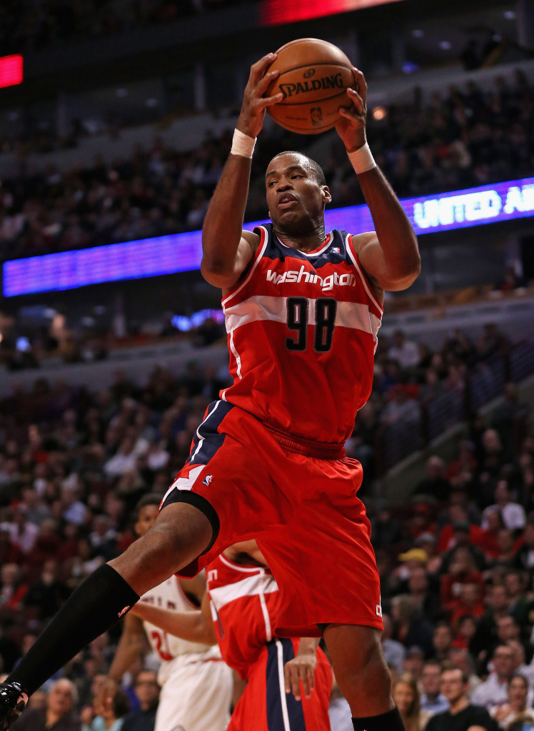 Jason Collins #98 of the Washington Wizards rebounds against the Chicago Bulls at the United Center on April 17, 2013 in Chicago, Illinois.