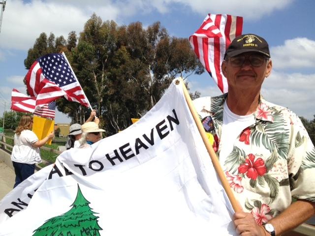A sign belonging to volunteer members of We The People California's Crusader.