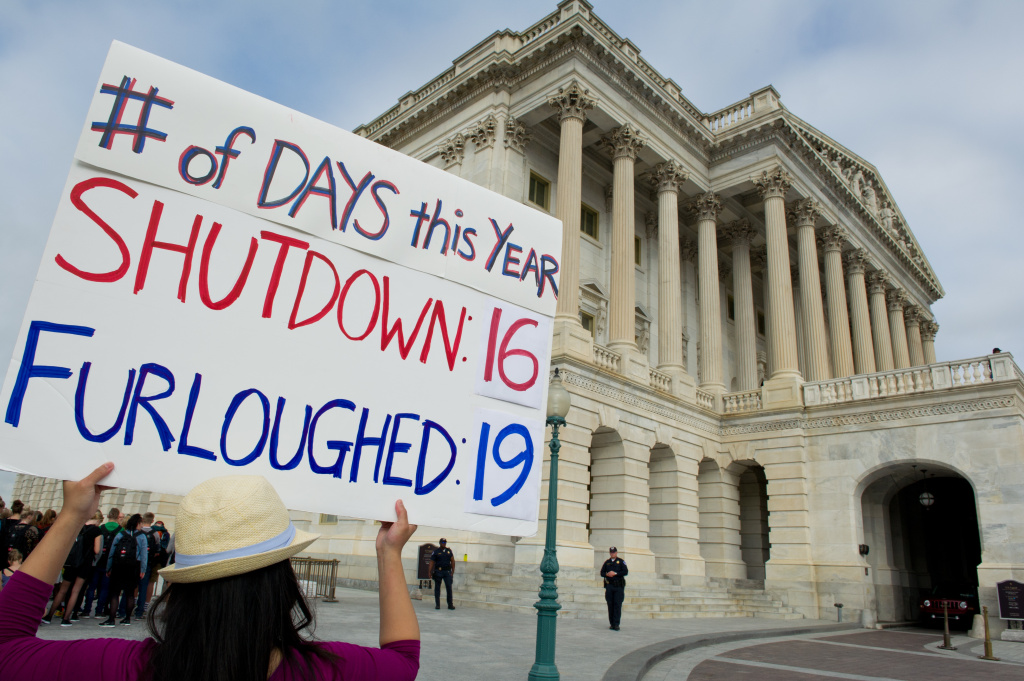 A furloughed government employee protests at the US Capitol October 16, 2013 in Washington, DC. US lawmakers embarked on another day of high-stakes political brinkmanship Wednesday, battling to scrape together an eleventh hour deal to protect Washington's battered financial standing.