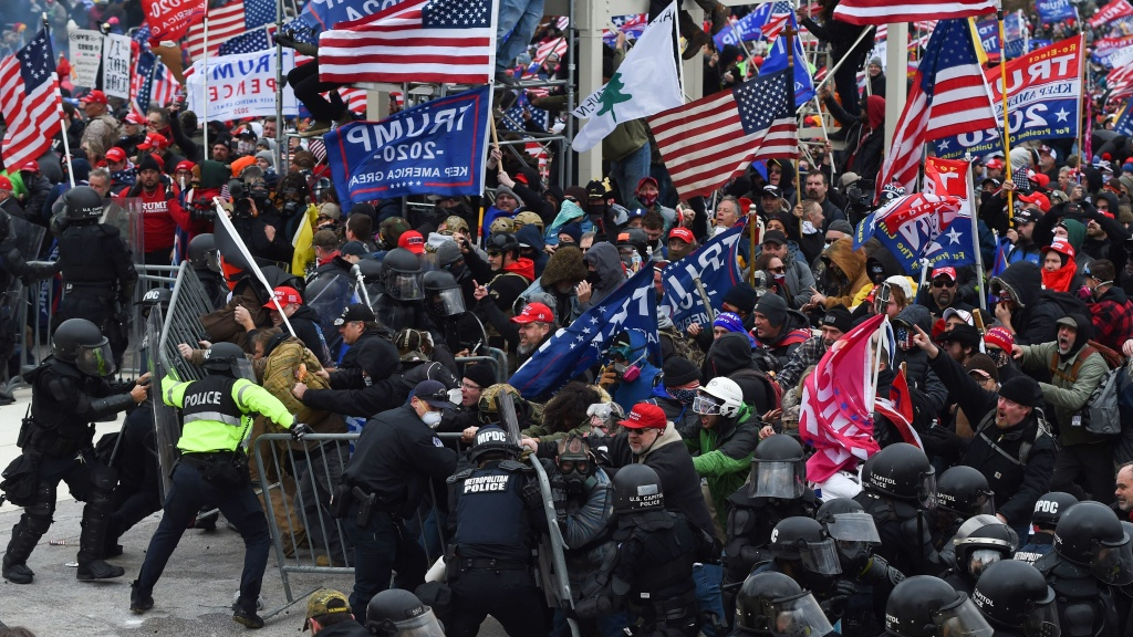 Rioters clash with police as they push barricades to storm the U.S. Capitol on Jan. 6, 2021.