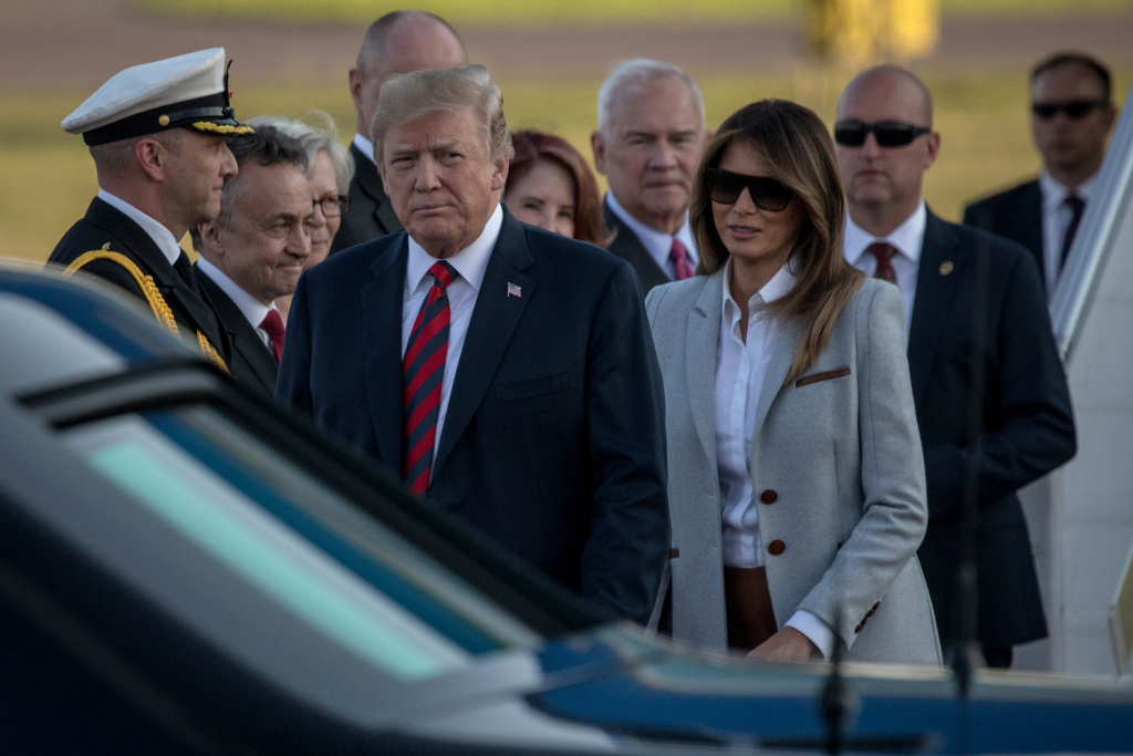 President Trump and first lady Melania Trump arrive in Helsinki, Finland, on Sunday ahead of a meeting with Russian President Vladimir Putin. Trump is under increasing pressure to confront Putin directly about special counsel Robert Mueller's indictment of 12 Russians accused of conspiring to interfere in the 2016 election.