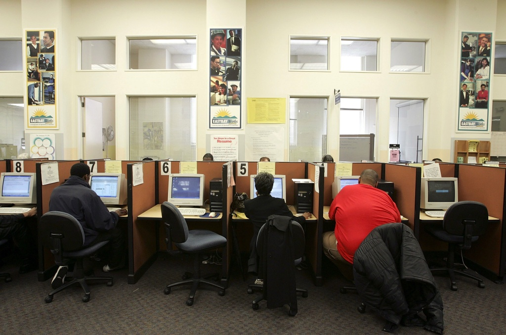 Job seekers use computers to search the Internet for jobs at a Northern California job center. The Labor Department said Thursday that weekly applications for unemployment benefits jumped 38,000 to a seasonally adjusted 368,000. The increase comes after applications plummeted in the previous two weeks to five-year lows.