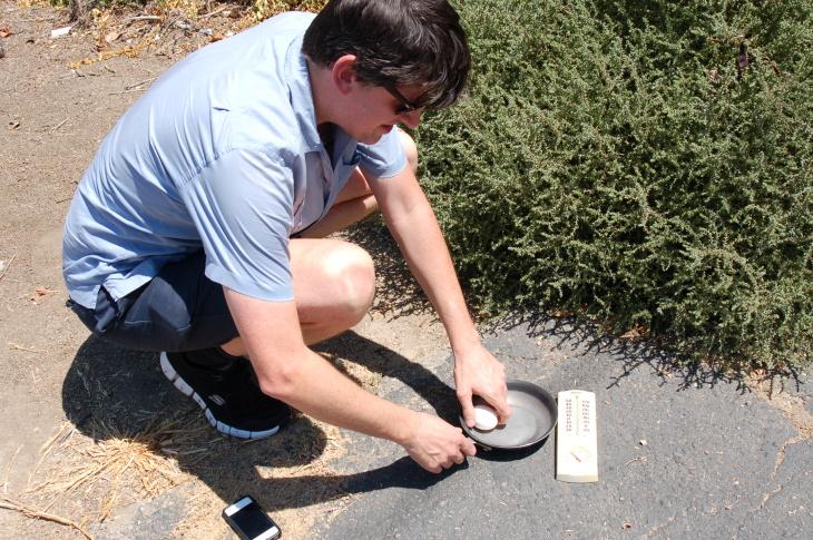 KPCC's John Rabe in Sherwood Forest preparing to fry an egg on the sidewalk.