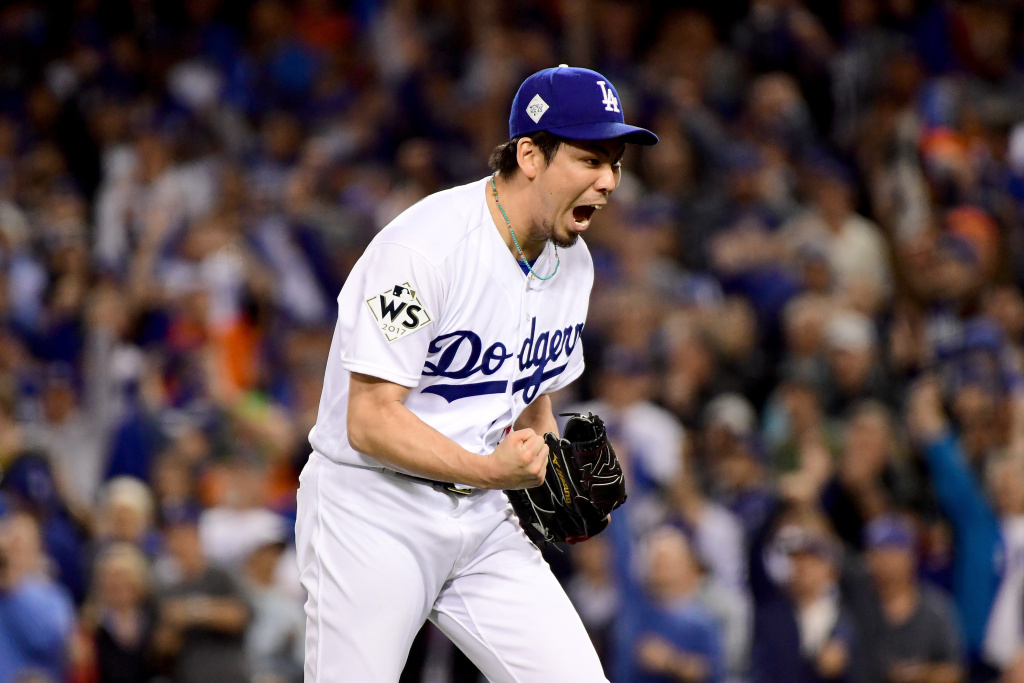 Kenta Maeda of the Los Angeles Dodgers reacts after the final out in the seventh inning against the Houston Astros during game six of the 2017 World Series.