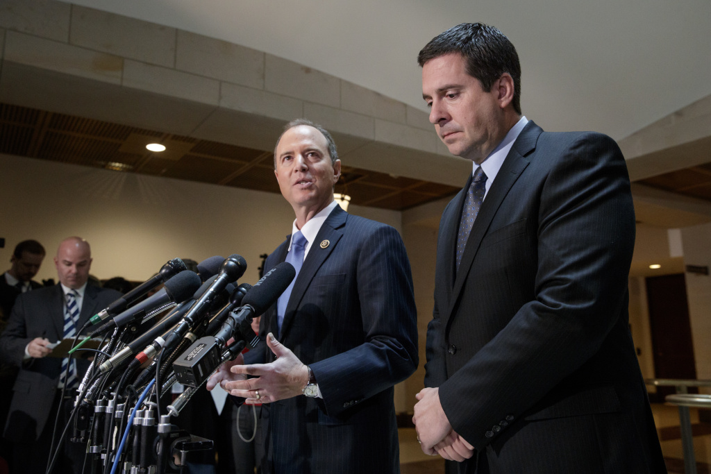 House Intelligence Committee Chairman Rep. Devin Nunes, R-Calif., listens at right, as the committee's ranking Democratic member,  Rep. Adam Schiff of Burbank, talks to reporters on Capitol Hill on March, 15, 2017, about their investigation of Russian influence on the American presidential election.