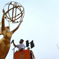 Painter Eddie Garcia touches up a statue of the Emmy Award on Sept. 12, 2017 in Los Angeles, ahead of this weekend's 69th Emmy Awards.