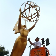 Painter Eddie Garcia touches up a statue of the Emmy Award on September 12, 2017 in Los Angeles, ahead of this weekend's 69th Emmy Awards.
