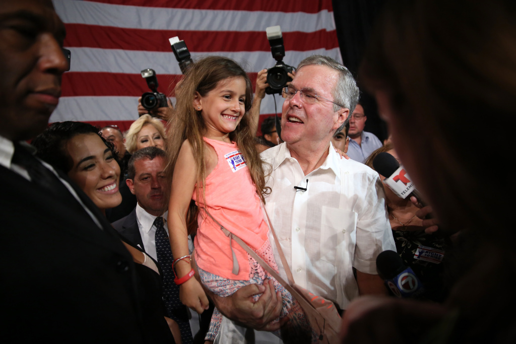 Former Florida Governor and potential Republican presidential candidate Jeb Bush greets people as he attends a fundraising event at the Jorge Mas Canosa Youth Center on March 18, 2015 in Sweetwater, Florida.