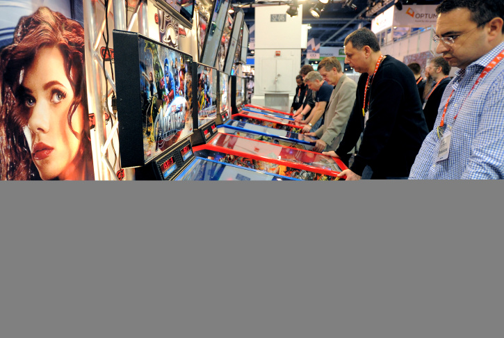 Pinball wizards Joshua Henderson (L) and Josh Sharpe (R) play on August 16, 2011 in Sharpe's basement, which houses 17 pinball machines. They are among a growing number of pinball enthusiasts who are keeping the game alive even after arcades were emptied by computer games and home systems like Nintendo. Just one pinball maker remains now that sales have fallen from 100,000 to 6,000 machines a year - Chicago's Stern Pinball.
