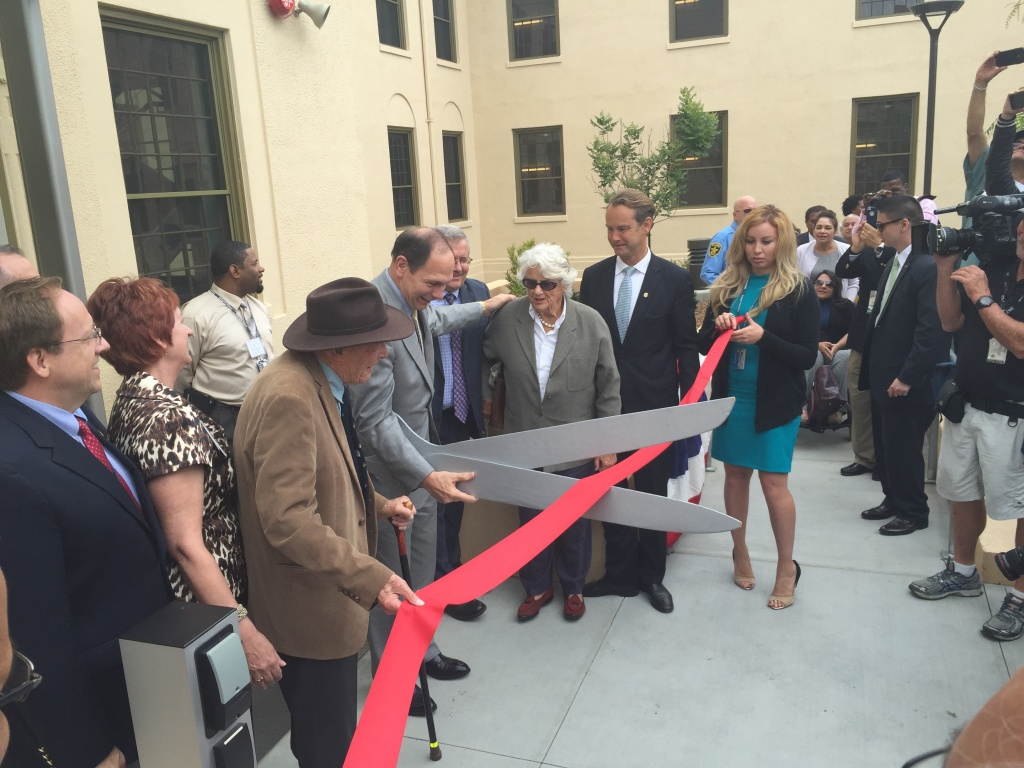 VA Secretary Bob McDonald cuts the ribbon opening the renovated Building 209 on the West LA Veterans Campus on June 4th 2015. The building will house 65 vets and cost $20 million to renovate.