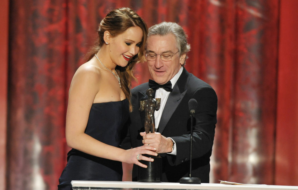 Jennifer Lawrence, left, accepts an award from Robert DeNiro on stage at the 19th Annual Screen Actors Guild Awards at the Shrine Auditorium in Los Angeles on Sunday Jan. 27, 2013.