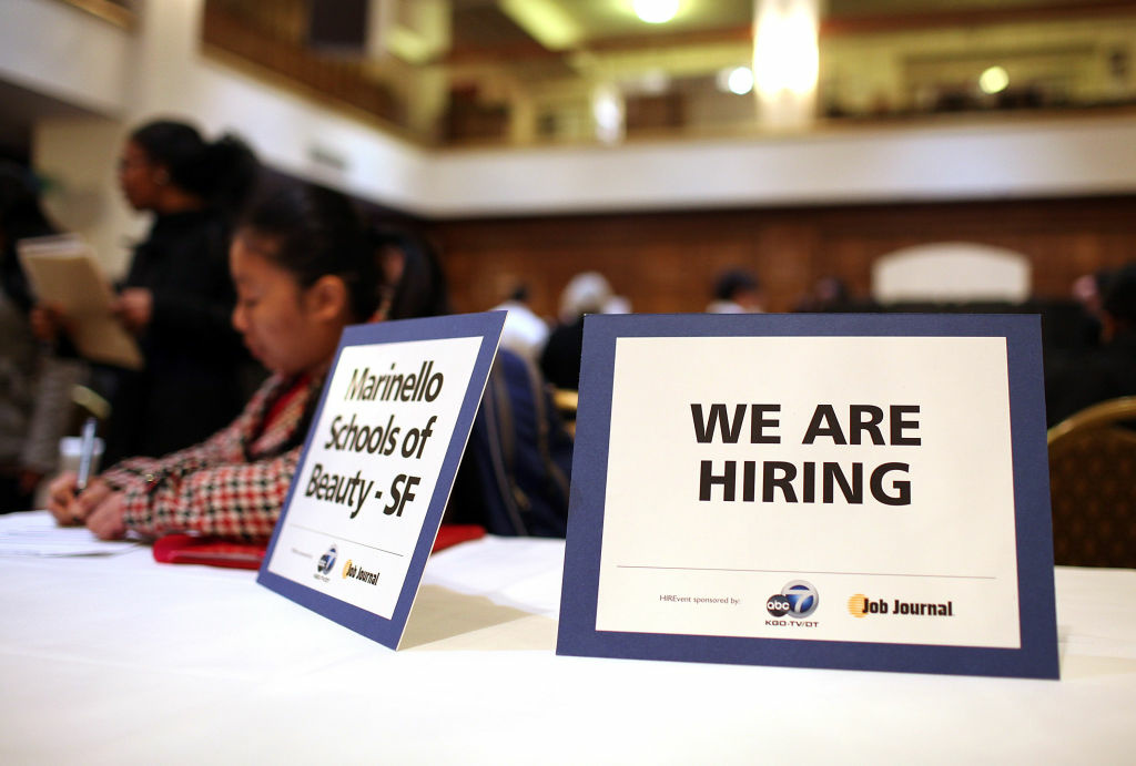 The Labor Department said Thursday that applications for unemployment benefits over the past month has fallen to its lowest level in almost six years, signaling fewer layoffs. (File photo: A
