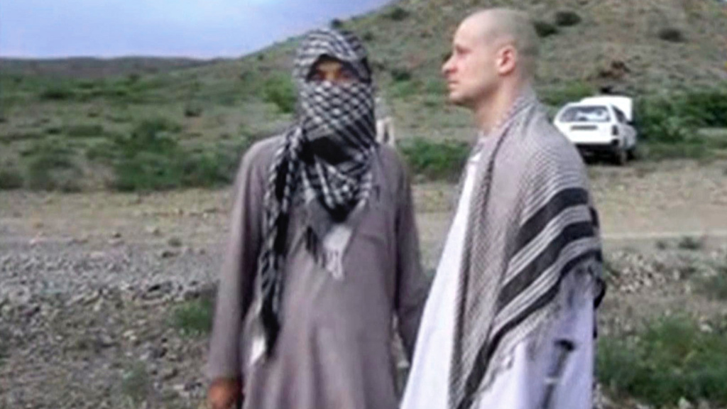 An image taken from a video obtained from the Voice of Jihad website shows Sgt. Bowe Bergdahl (right) with a Taliban fighter just before he was released to U.S. forces in eastern Afghanistan.