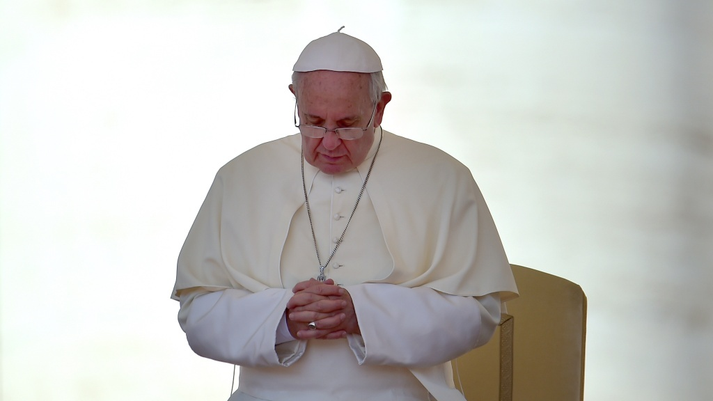 Pope Francis prays during his general audience in Saint Peter's Square at the Vatican on June 3. The pope has made statements supporting the idea that climate change is man-made, and his upcoming encyclical on the environment and poverty is highly anticipated.
