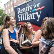 Supporters of Hillary Clinton wait as pro-Clinton volunteers hand out posters and bumper stickers at George Washington University in Washington on June 13, 2014.