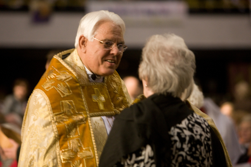 Bishop J. Jon Bruno greets a member of the congregation at the Peace.